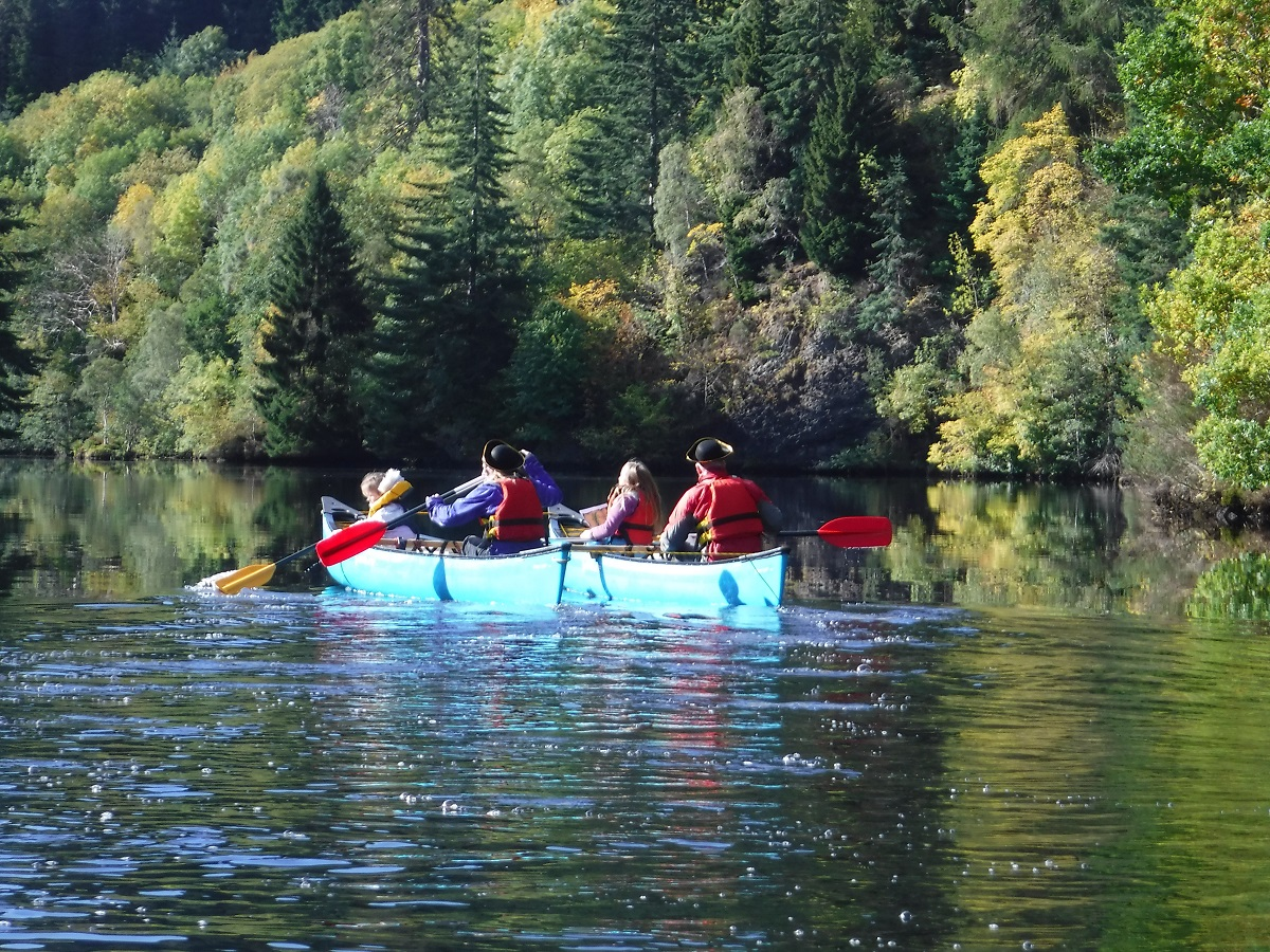 Family canoeing together