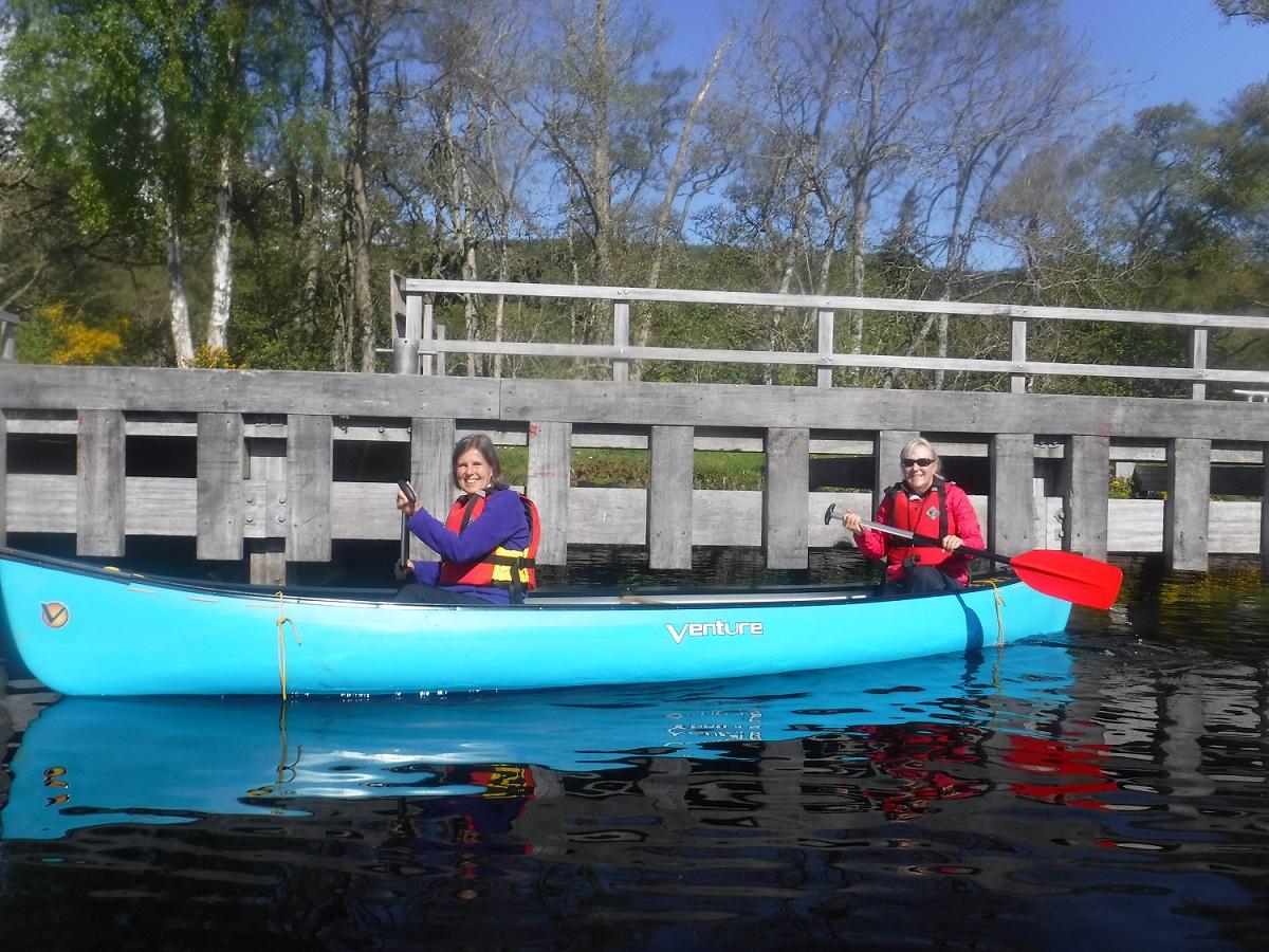 Two ladies canoeing