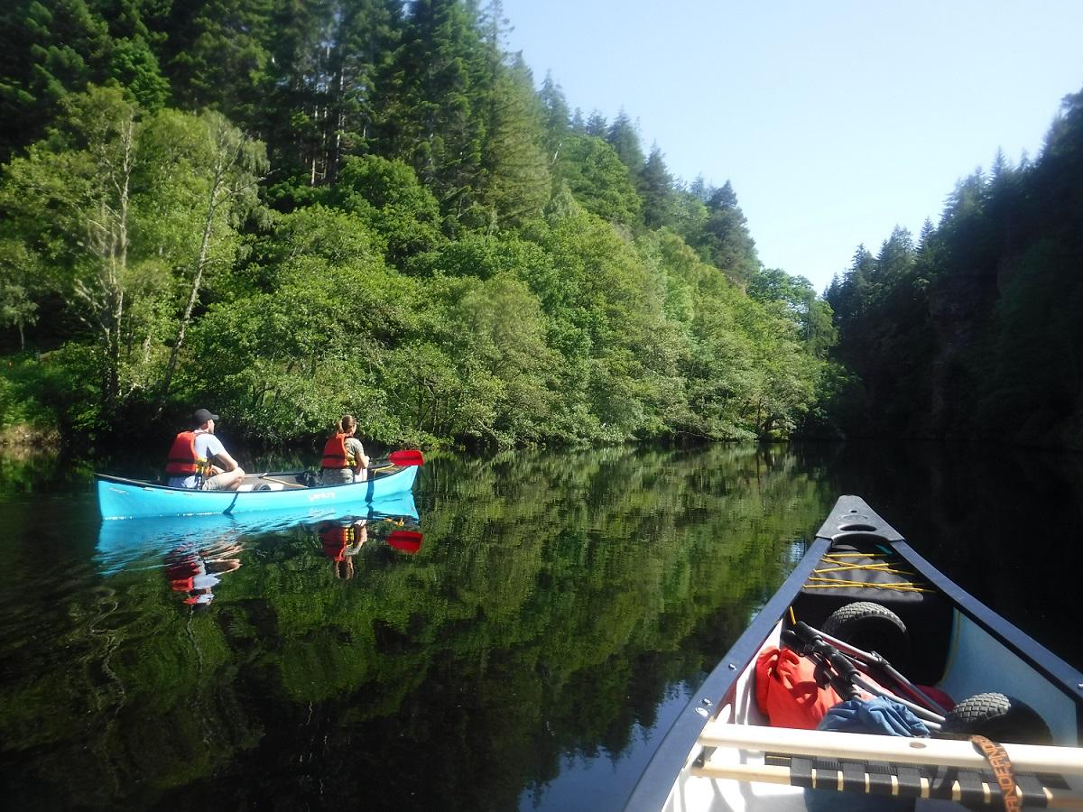 Canoeist on a gentle river