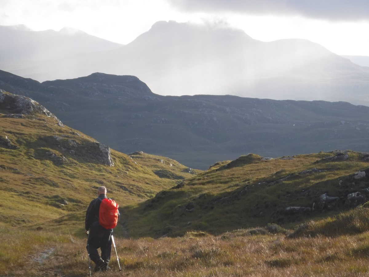 Hiker coming of Suilven