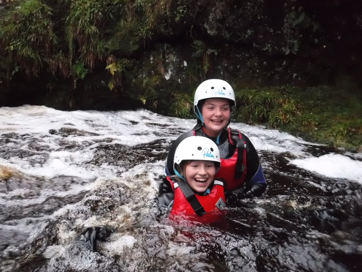 Two sisters having an amazing time gorge scrambling with Liquid Footprints